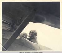 Unknown woman sitting in airplane