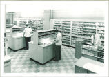 Pharmacists working in a pharmacy, The University of Iowa, December 1954