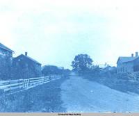 "Street scene of ""back street"", Amana, Iowa, 1900s"