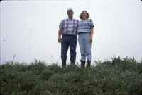 Linda and Dana Sitzmann pose in the newly constructed terrace in the field.