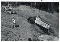 1977 Merrimac Construction Company Truck hauls dirt