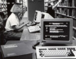 Student using early library computer
