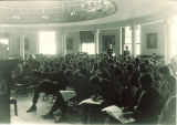 Students taking an exam in an auditorium in Schaeffer Hall, The University of Iowa, between 1915 and 1920