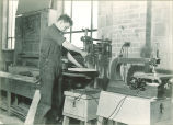Drama student drilling a block of wood for set building, The University of Iowa, April 4, 1941