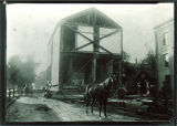 Horse and workmen moving a building on campus, The University of Iowa, 1890s