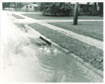 Flooded street by Theatre Building, The University of Iowa, June 1962