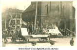 Mecca Day parade float passing by Congregational Church on Clinton Street, The University of Iowa, 1916