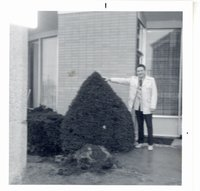 Daryl Hicks with transplanted tree in front of Maquoketa State Bank
