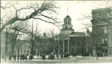 Students walking on the Pentacrest in front of Old Capitol, The University of Iowa, 1920