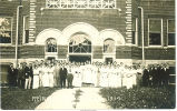 Crowd of men and women posed outside banquet hall, Reinbeck, Iowa, August 28, 1914