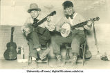 Students in costumes playing banjos, The University of Iowa, 1950s?