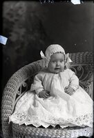 Infant in bonnet