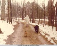 Elizabeth wearing fur coat, walking with cory and Sadie
