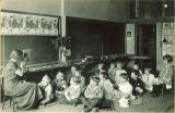 Teacher reading to class, The University of Iowa elementary school, 1920s