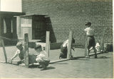 Students putting up a chicken fence, The University of Iowa elementary school May 1932