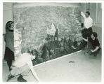 Art students remounting 'Symphony of Iowa' mural by Mildred Pelzer Lynch, The University of Iowa, 1960s