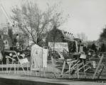 """Pi Phi lawn display, """"""""We'll clean up tomorrow,"""""""" Homecoming, 1949"""