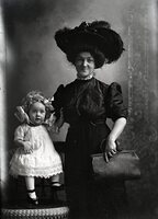 Woman and toddler girl in hat