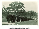 Commencement procession walking east on Pentacrest, The University of Iowa, June 1931