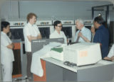 Earl O. Heady discussing new computer equipment with four men at the Office of Agricultural Economics computer center in Bangkok, Thailand, 1983