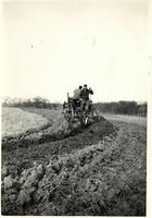 Men in field on farm machinery