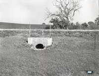 Water culvert with fence by road
