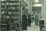 Men in the store room of the Chemistry Building, The University of Iowa, 1930s