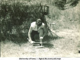 Making a fire at Marjory Camp, The University of Iowa, 1930?