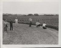 Group of Men Examine Keith Gaumer's Farm.