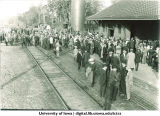 Crowd gathered at depot waiting for football train, The University of Iowa, 1913