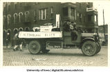 Brewery equipment on float in Mecca Day parade, The University of Iowa, 1920