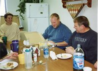 2005 - NRCS Soil Conservationist TJ Mathis and District Employee Dale Schmeiser sit at a table
