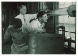 Working with apparatus in Hydraulics laboratory, The University of Iowa, 1940s