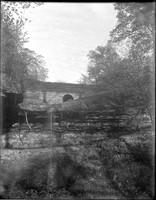 LG 127  Stone arch over cascade
