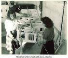 Elinor Kohrs, Harriet Brown, and Idella Benton with pre-flight signal code flags, The University of Iowa, 1942-43