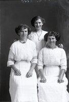 Three women in white dresses