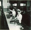 Pharmacy students preparing drugs in laboratory, The University of Iowa, 1940s