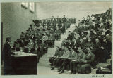 Teacher with students in Chemistry-Botany-Pharmacy lecture hall, The University of Iowa,1920s