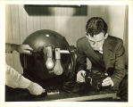 Engineering student working with electrical device, The University of Iowa, 1940s