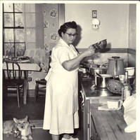 Mildred Hahlen cooking in White house kitchen with corgy at her feet