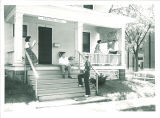 Students on front porch of the International Center, The University of Iowa, June 1954