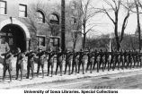 Cadets aiming rifles south of Old Armory, The University of Iowa, 1919
