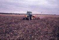 Tractor plowing field, 1981