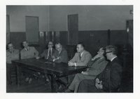 Seven Unidentified  Men Meet Around Table