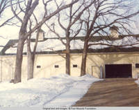 Front of barn with garage door open in winter