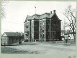 New Women's Gymnasium, left, and Calvin Hall, The University of Iowa,  ca. 1920