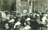 Elementary school teacher reading to class, The University of Iowa elementary school, 1920s