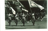 Scottish Highlanders with flag bearers, The University of Iowa, 1979