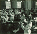 Students mixing drugs in pharmacy laboratory, The University of Iowa, November 8, 1940