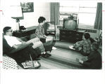Family watching television in the Hawkeye Drive Apartments, the University of Iowa, August 1966